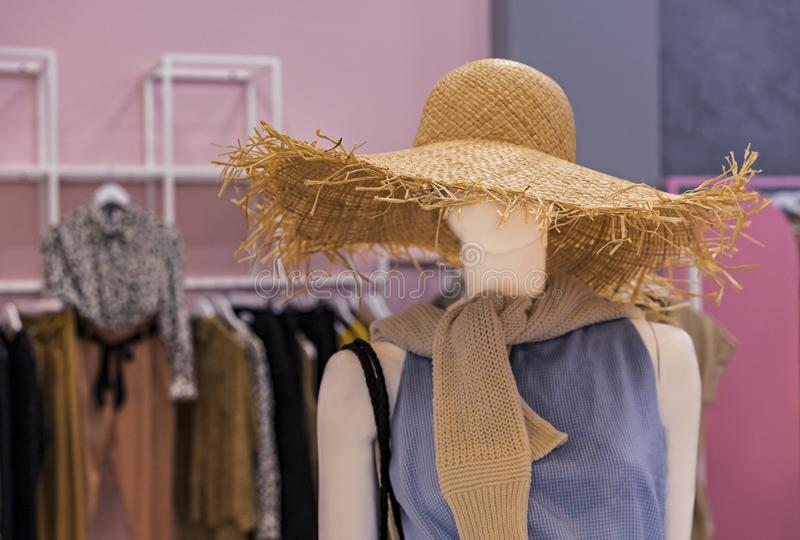 Female mannequin with summer clothes and a big straw hat royalty free stock photography