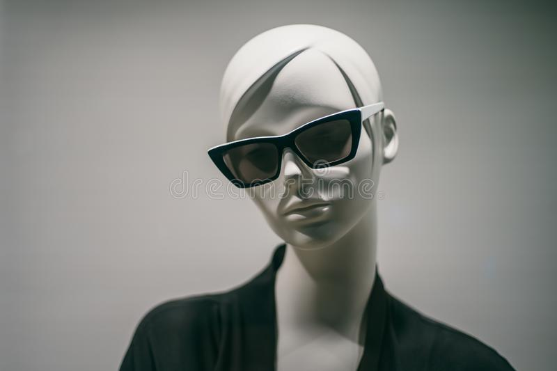 Female mannequin in sunglasses in boutique. Dummy head close up in fashion store stock image