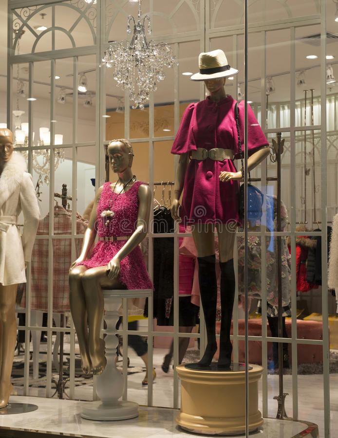 female mannequins in a fashion clothing shop window royalty free stock image