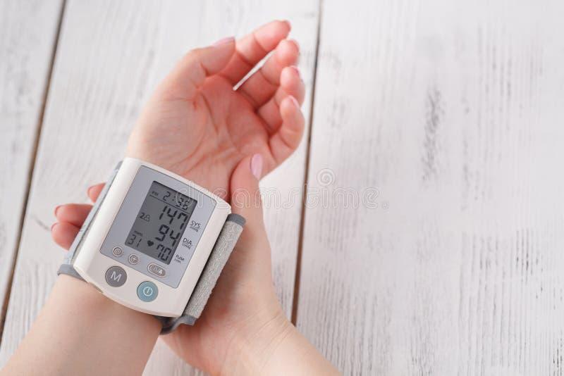 Female measure blood pressure stock image