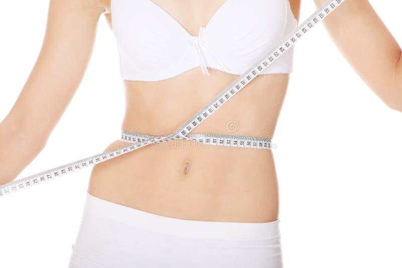 Female measuring her body stock photos