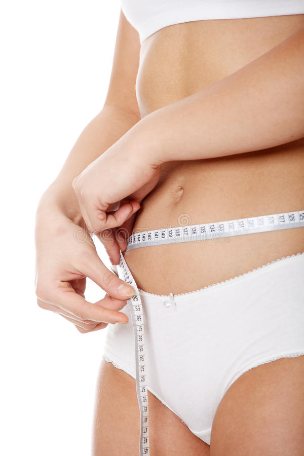 Female measuring her body royalty free stock photography