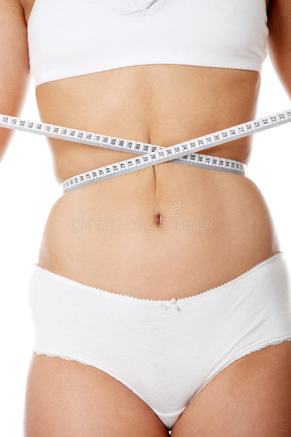 Female measuring her body stock images