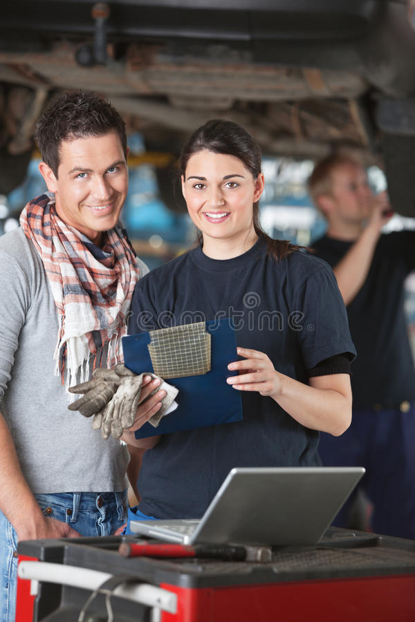 Download Female Mechanic With Customer Stock Image - Image: 20298571