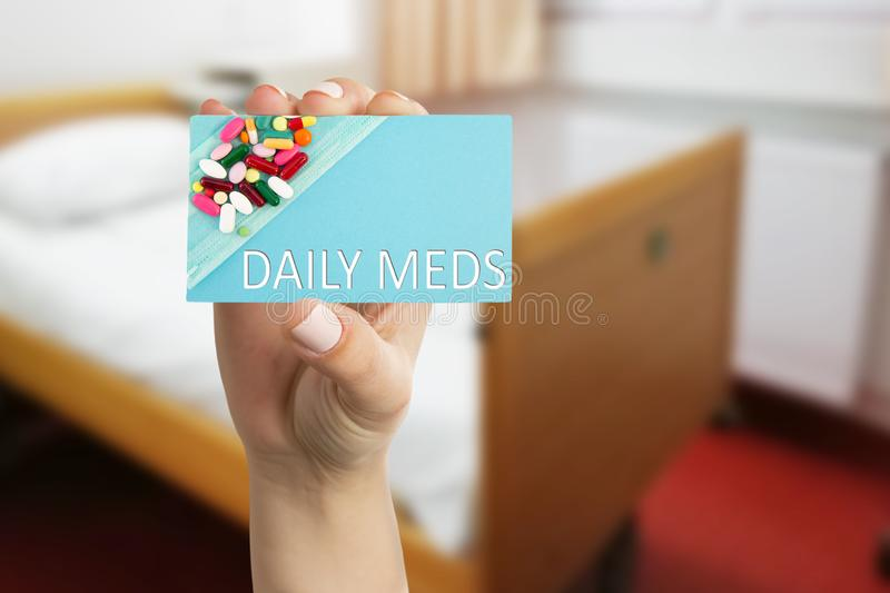 Medic presenting daily meds text on card stock photography