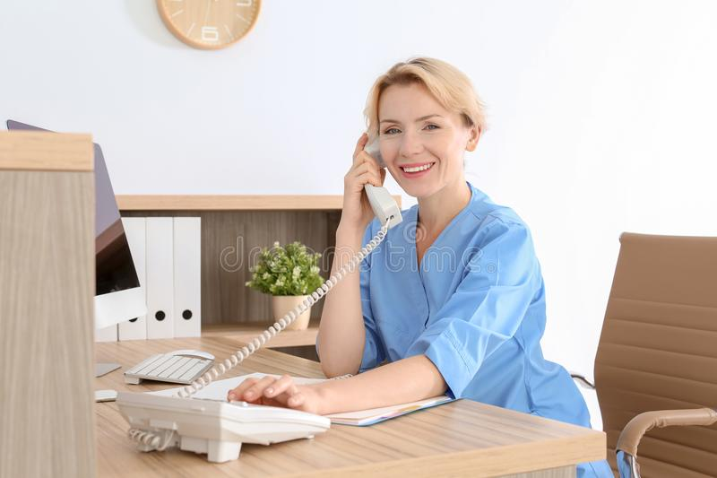 Female medical assistant at workplace in clinic royalty free stock photography