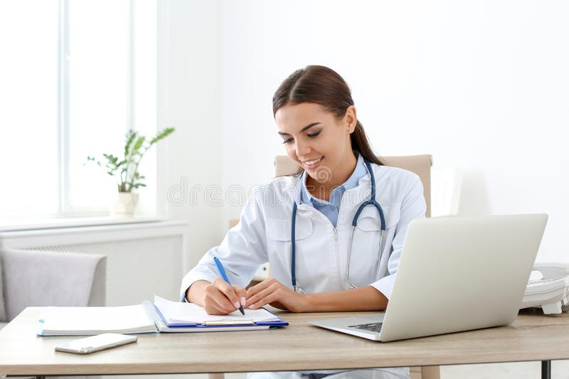 Female medical assistant at workplace. In clinic. Health care service royalty free stock photos