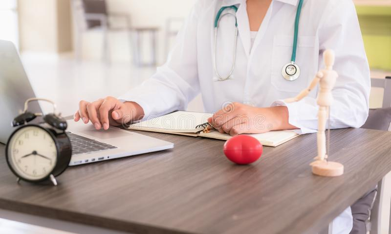 Female medical doctor using laptop at her office, Healthcare and stock images