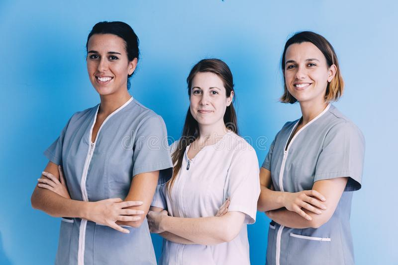 Female Medical Team at hospital. Standing looking at camera stock images