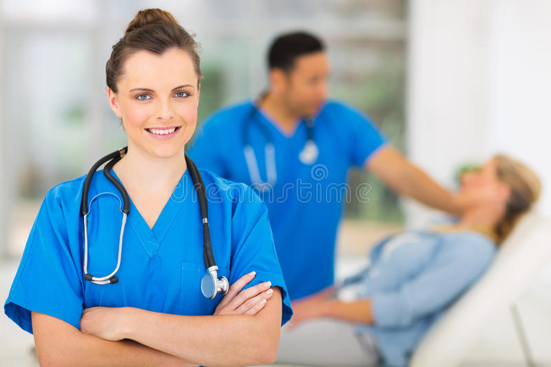 Female medical worker. Attractive young female medical worker in office stock photo