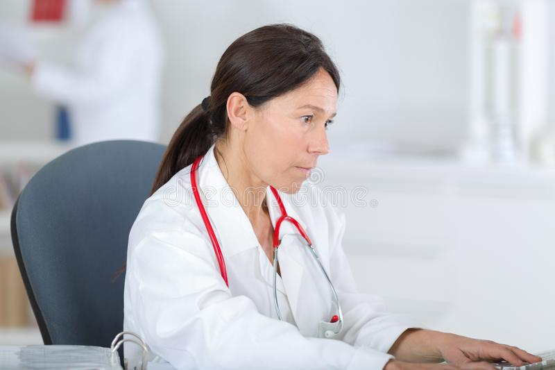 Female medical worker using computer royalty free stock photos