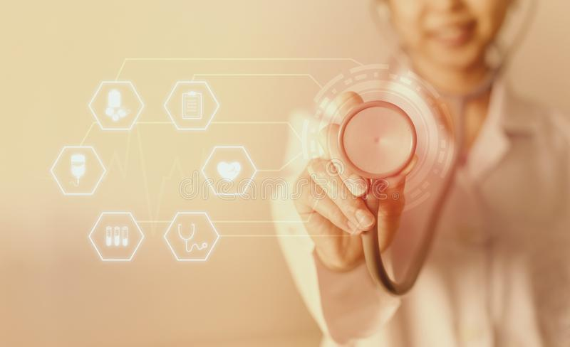 Female medicine doctor standing and holding stethoscope for check patient with icon medical. stock image