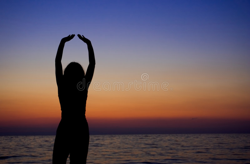 Female meditating royalty free stock photography