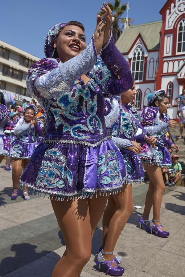 Arica Carnival in Chile, South America. Female members of a Caporales dance group in ornate costumes performing at the annual Carnaval Andino con la Fuerza del stock photos