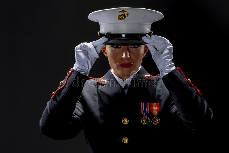 A United States Female Marine Posing In A Military Uniform. A female military Marine posing in a military uniform stock photos