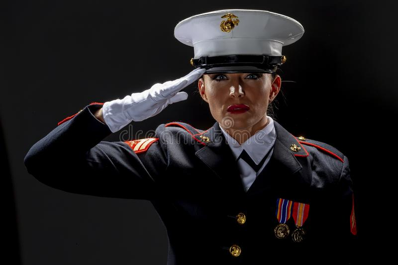 A United States Female Marine Posing In A Military Uniform. A female military Marine posing in a military uniform stock photo