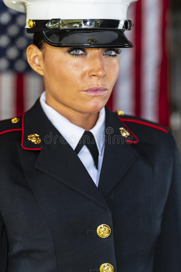 A United States Female Marine Posing In A Military Uniform. A female military Marine posing in a military uniform stock images
