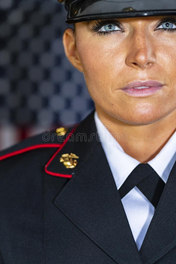 A United States Female Marine Posing In A Military Uniform. A female military Marine posing in a military uniform royalty free stock photos