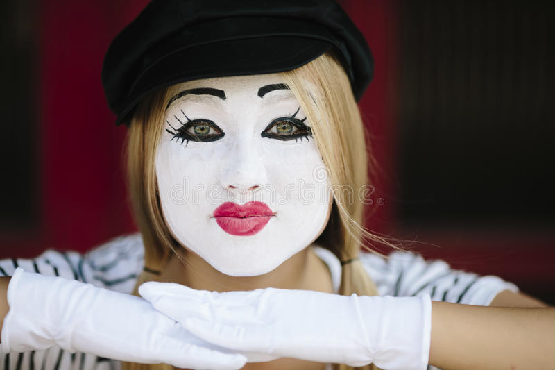Female Mime. Mime with black hat on the red background stock image