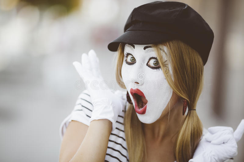 Female Mime. Portrait of mime with black hat and white gloves stock image