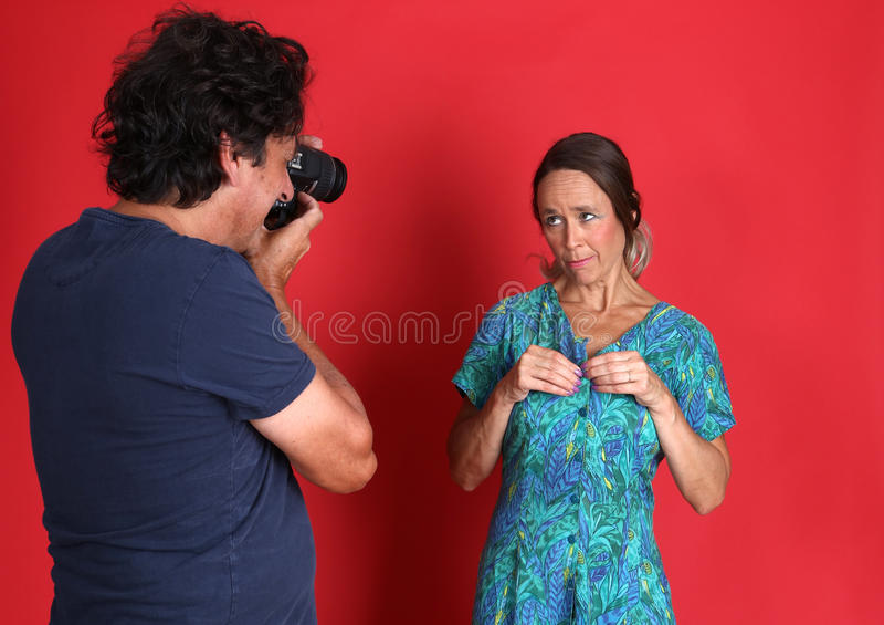 Female model being abused by a Photographer. Actually a mature model and her husband stock photo