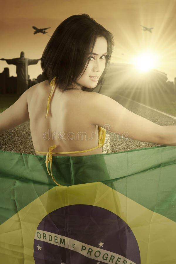 Female model with Brazilian flag on the road stock photos