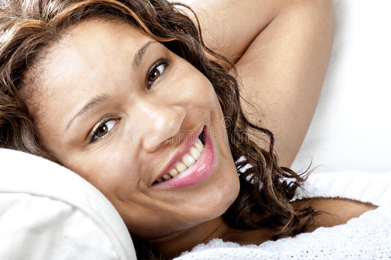 Female model on couch stock photography
