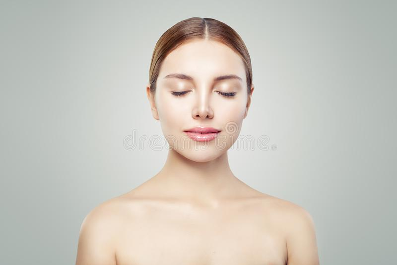 Female model face eyes closed. Young perfect woman with healthy skin. Facial treatment, skincare and cosmetology concept stock photos