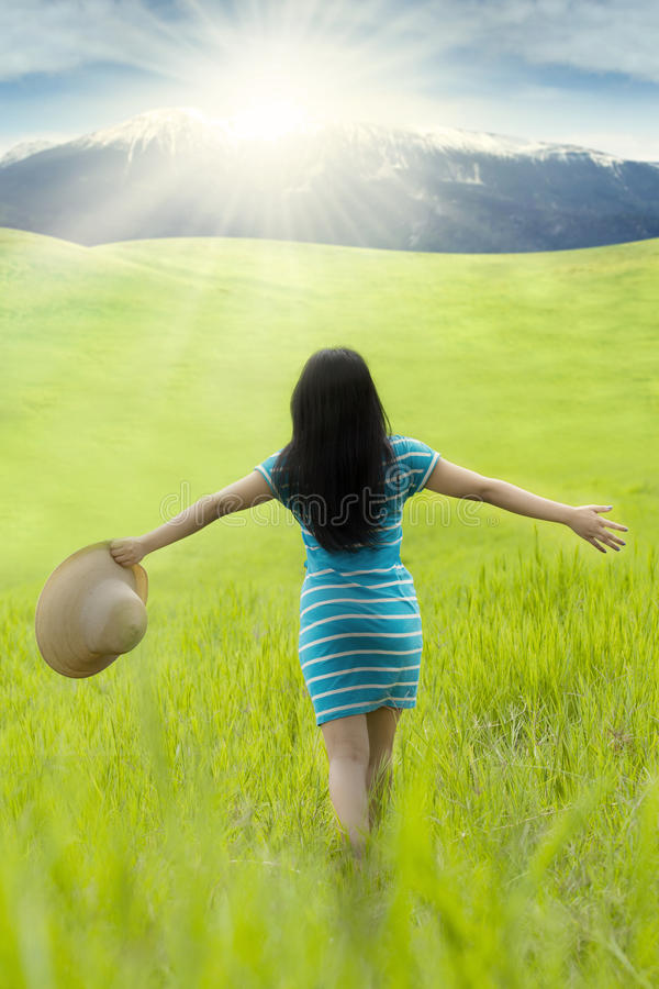 Female model with hat walks on meadow stock photos