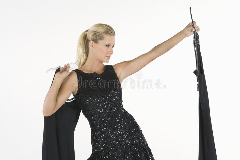 Female Model Selecting Dress royalty free stock image