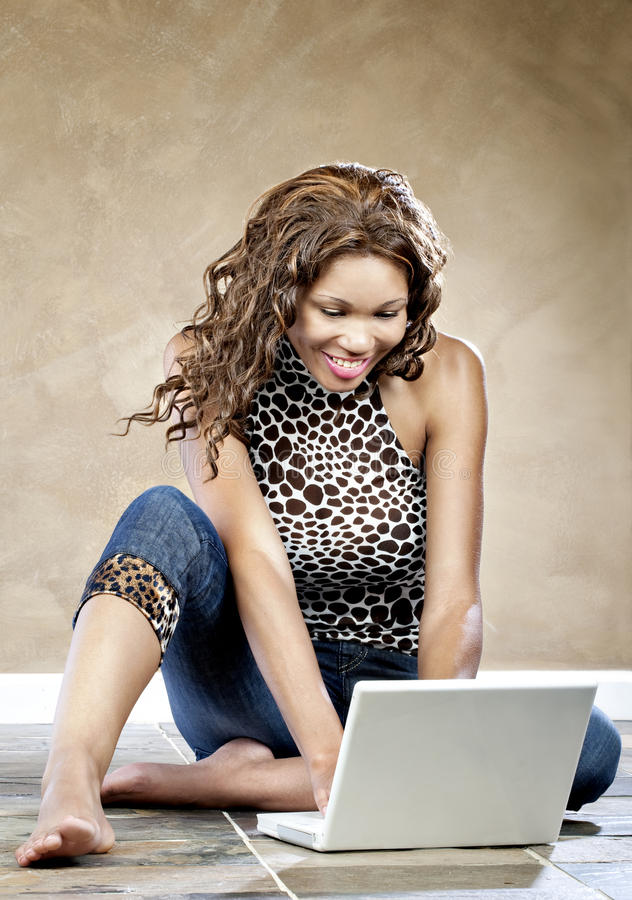 Female model using laptop stock photo