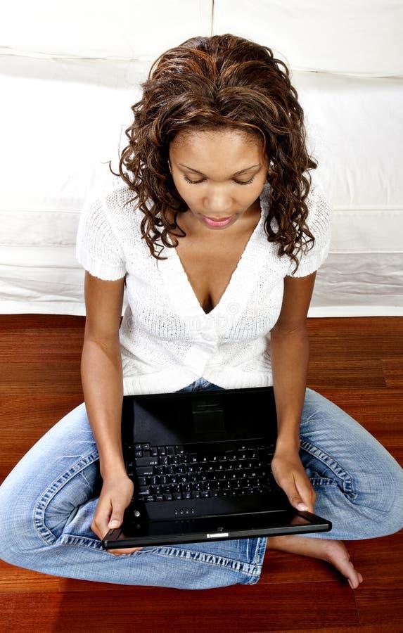 Female model using laptop stock image