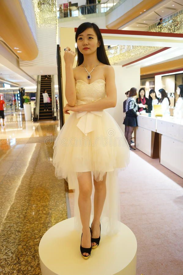 Female models, show gold jewelry. In Shenzhen, china stock photos