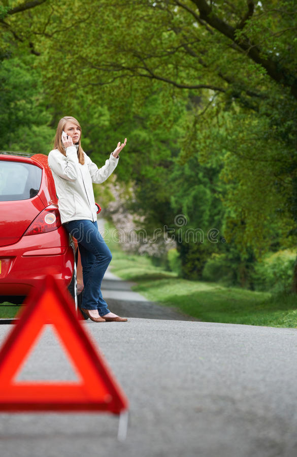 Female Motorist Broken Down On Side Of Road royalty free stock image