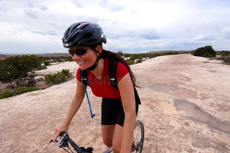 Female mountain biker royalty free stock photo