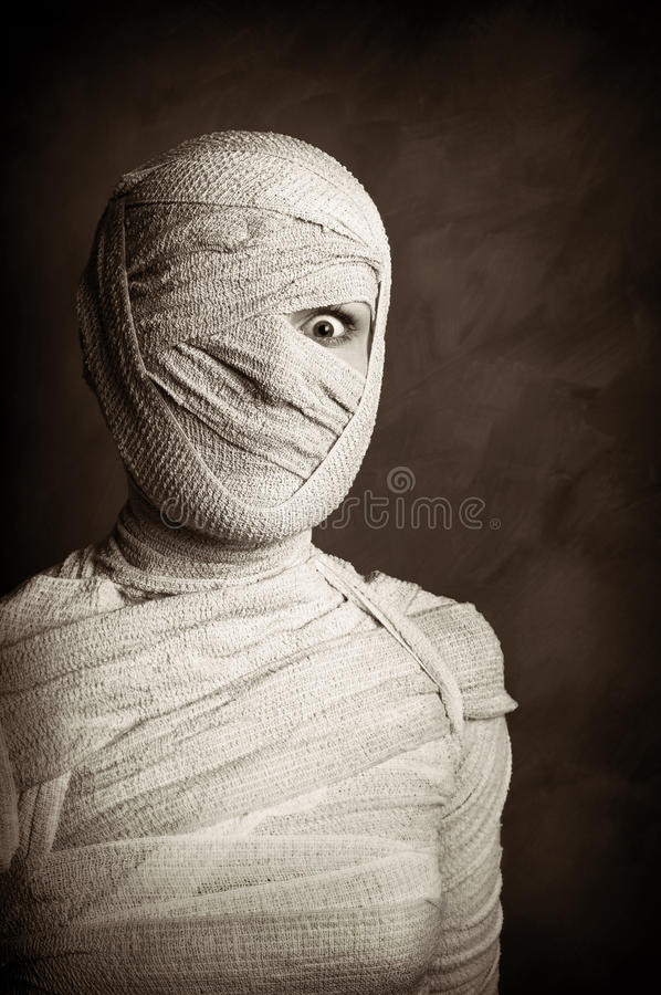 Female mummy retro style. Female mummy in grungy sepia vintage horror halloween style royalty free stock photo