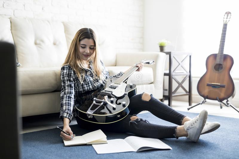 Female music artist writing a song stock photo
