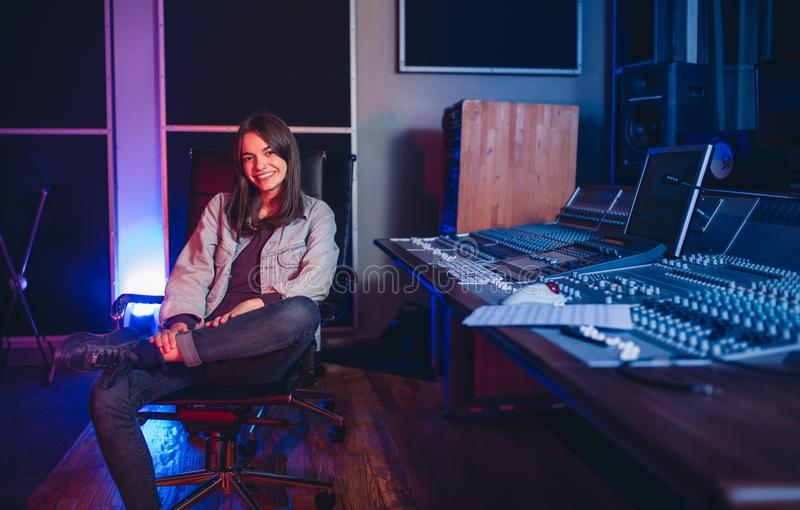 Female music composer at sound recording studio stock photography