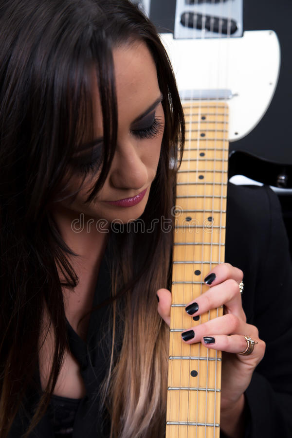 Female Musician/ Guitarist royalty free stock image