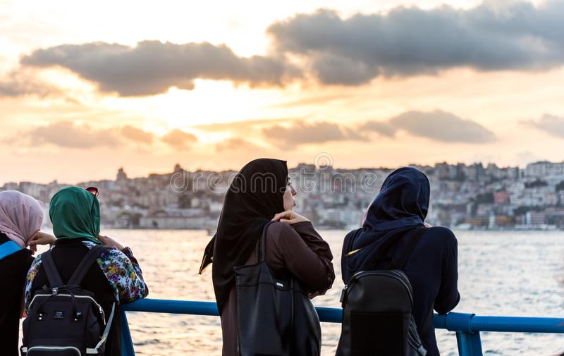 Female muslim tourists watching the sunset at the Corniche park at Uskudar, Istanbul, Turkey, on the Anatolian shore of the. Bosphorus royalty free stock images