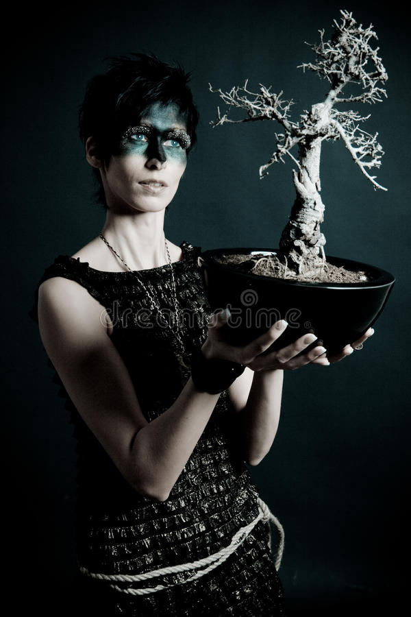 Female nature priest with holy tree stock photos