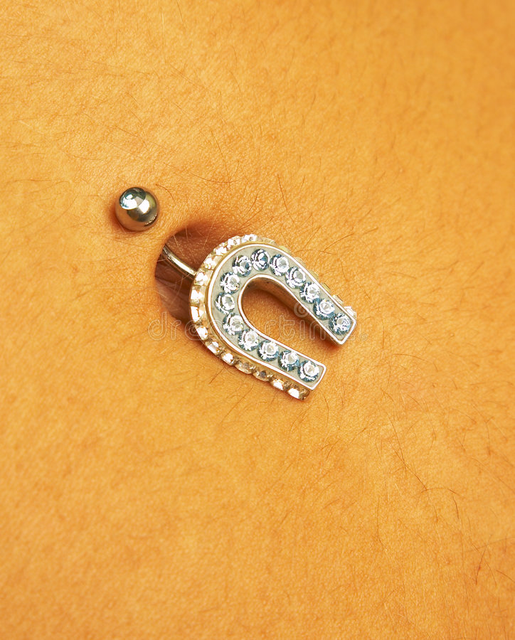 Female navel with piercing stock photos