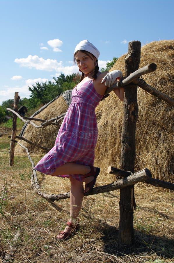 Female near haystacks stock image