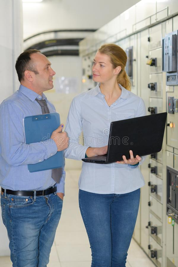 Female network engineer admin at data center stock images