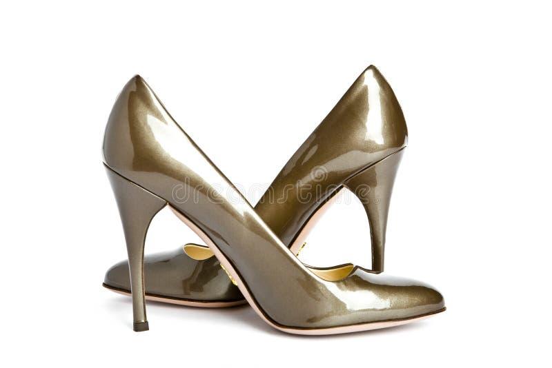 Female new varnished shoes on high heel-stiletto. Beige-golden female new varnished shoes on high heel-stiletto stock photo