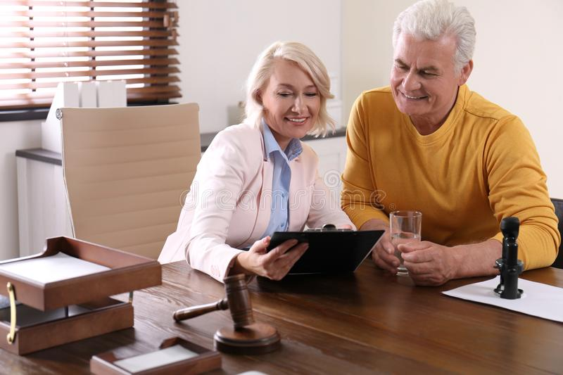 Female notary working with client stock photos