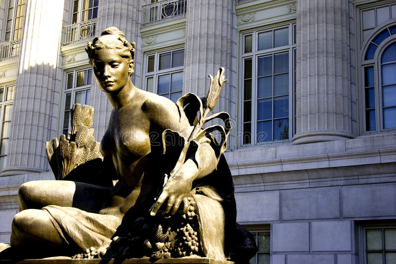 Female nude. Statue of a nude woman holding a stalk of corn in front of the state capital building in Jefferson City, Missouri stock photography