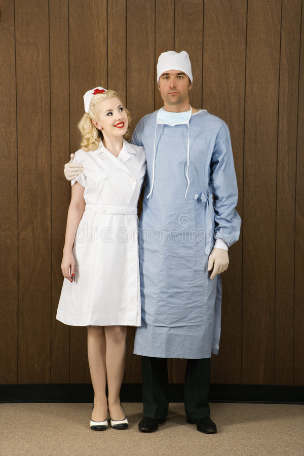 Download Female Nurse And Male Surgeon Standing Together. Stock Photo - Image: 2042630