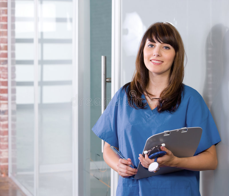 Female Nurse in a modern office. Holding a chart royalty free stock photos