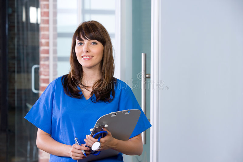 Female Nurse in a modern office. Holding a chart royalty free stock images